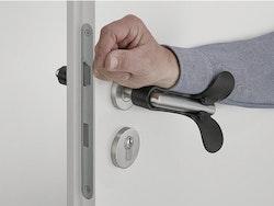 Påbyggnad för dörrtrycken