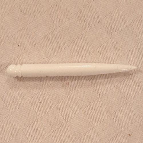 Pryl av vit plast