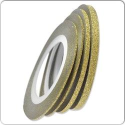 Striping tape glittrig guld