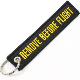 Mc-Nyckelring Remove before flight - svart