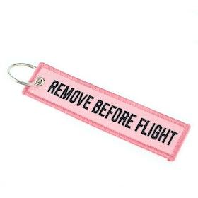 Mc-Nyckelring Remove before flight - rosa