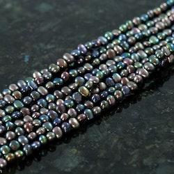 Blå ovala pärlor 4-4,5 mm