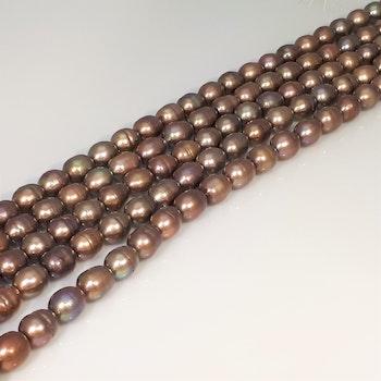 Nougat-bruna ovala pärlor 8x11 mm