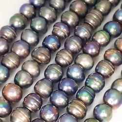 Blå-gröna pärlor 9-10 mm