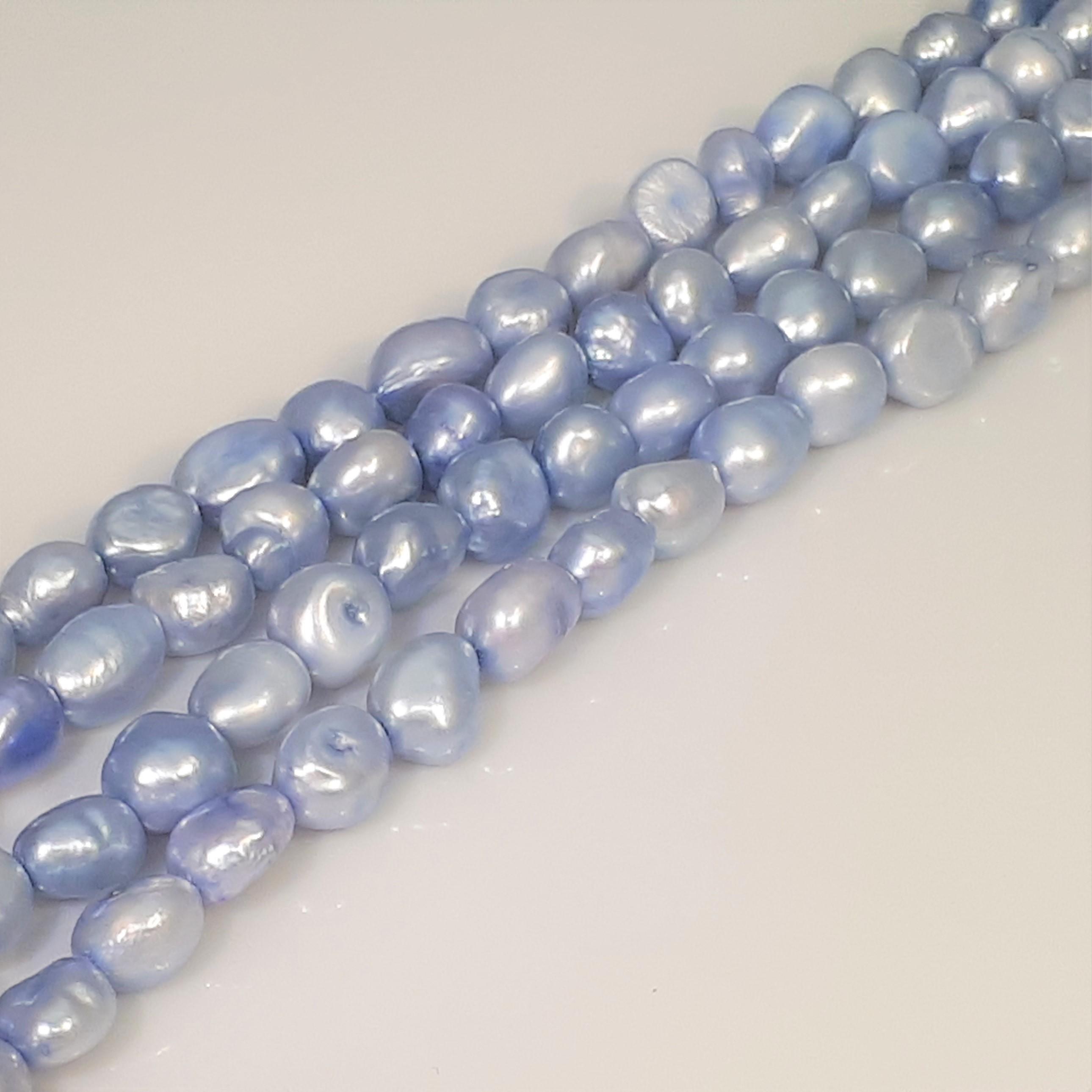Pärlor på sträng blå färger