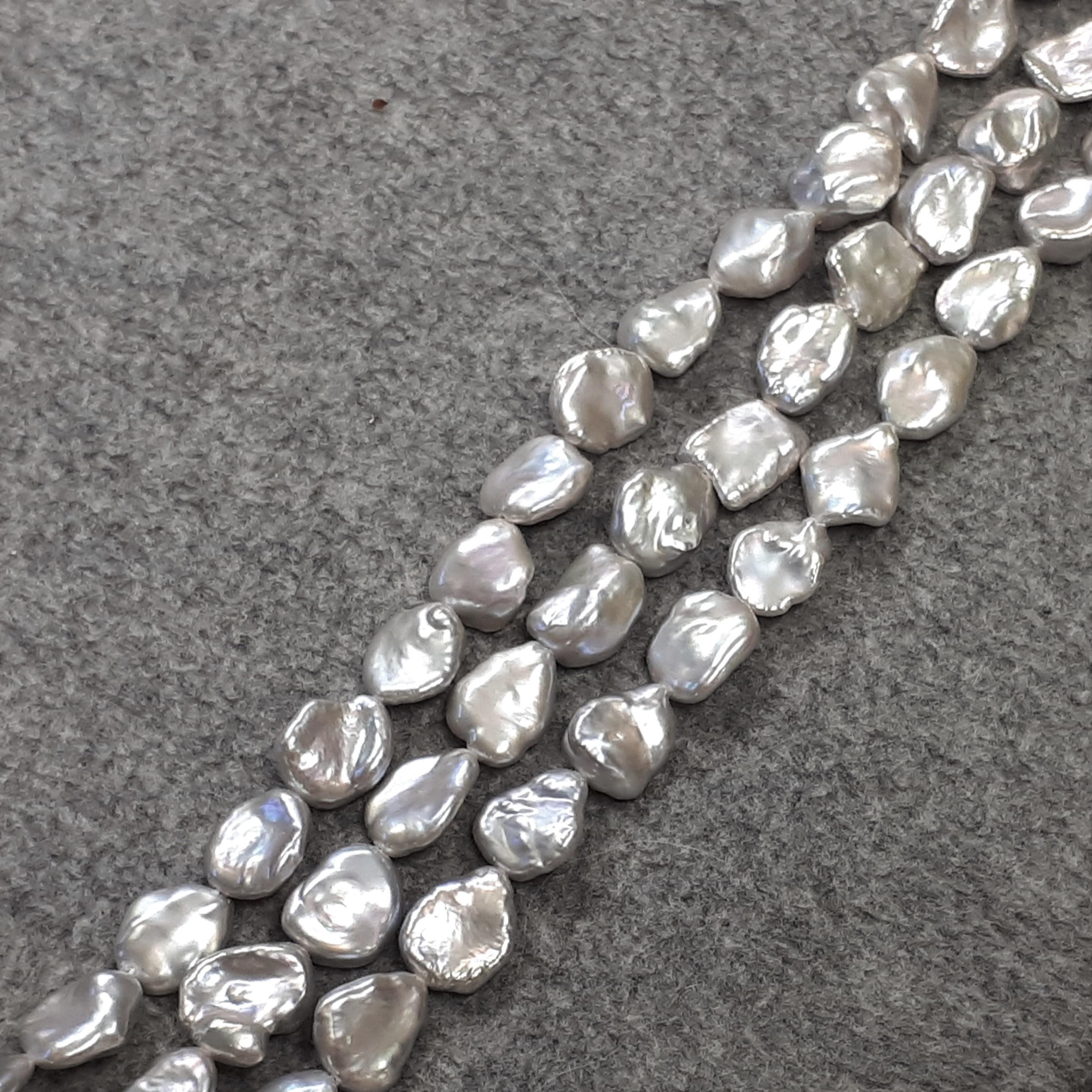 Silvergrå platta pärlor 8-10 mm