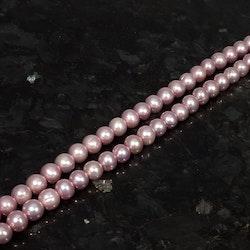 Rosa nästan runda pärlor 7,5-8 mm