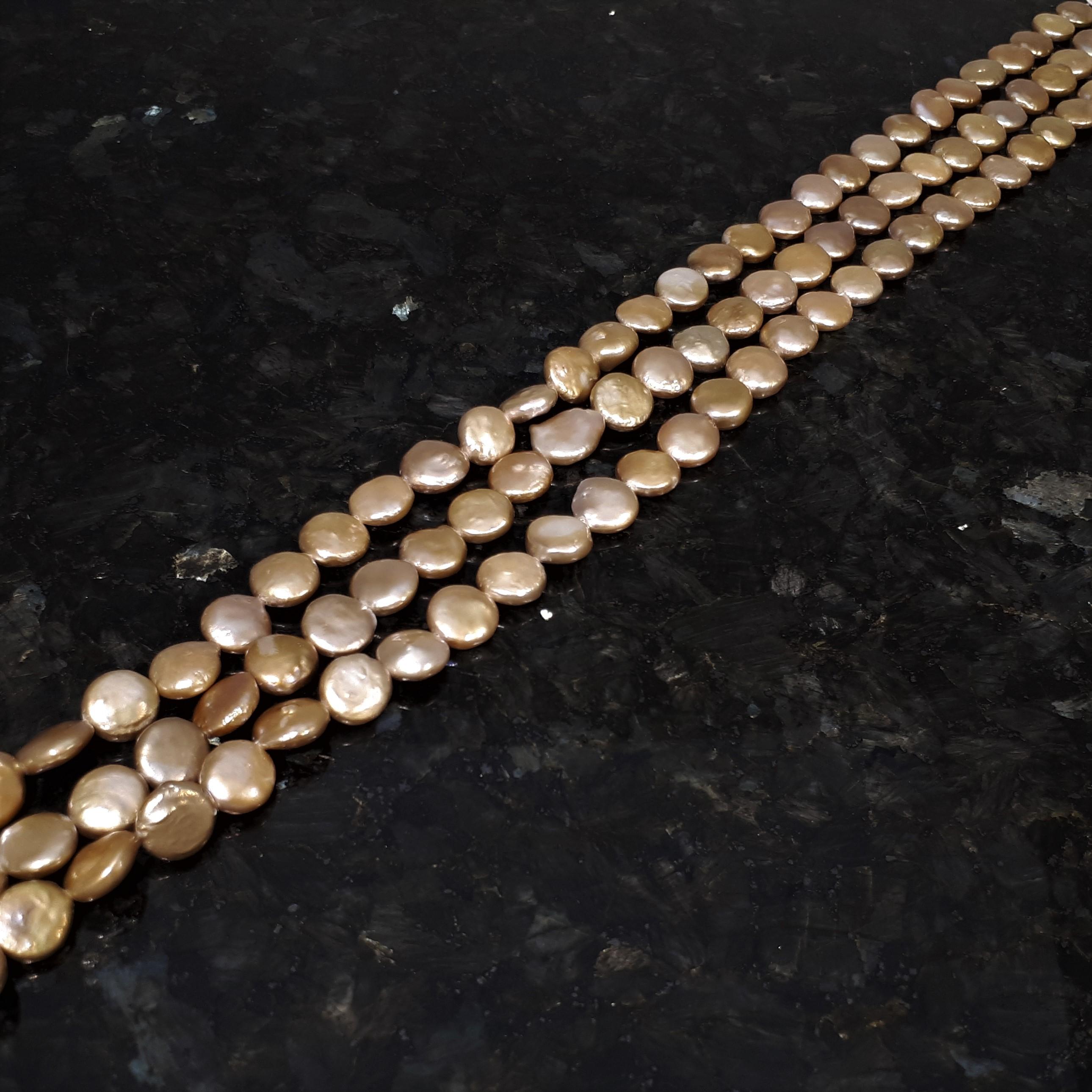 Guldfärgade myntpärlor 11-12 mm