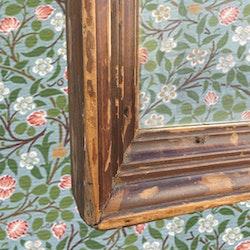 Spegel med ram i patinerad teak