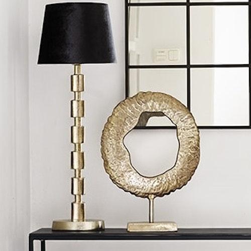 Rund dekoration i guld