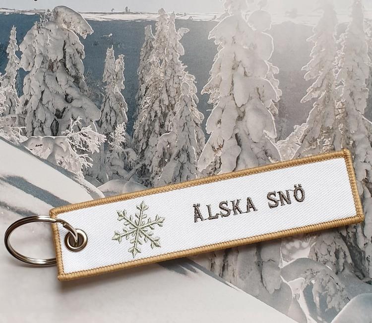 Tag/Nyckelring Älska snö