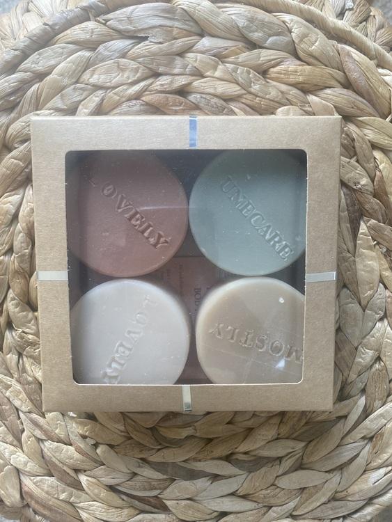 Fyra tvålar i presentförpackning
