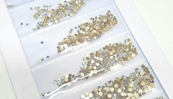 Klara stenar med guldbotten mixade storlekar  storlekar 1440 i förpackning