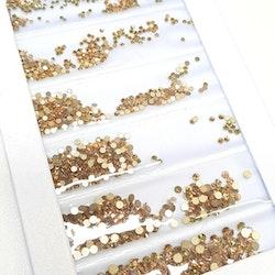 Gulfärgade stenar med guldbotten mixade storlekar  storlekar 1440 i förpackning