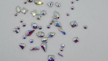 Stora Aurora stenar med silver botten mixade former ca 40 i påsen