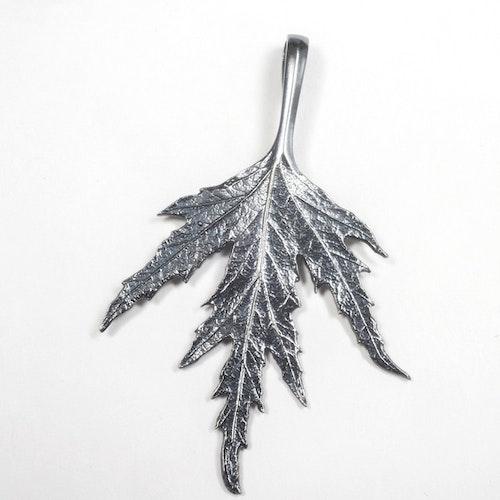Ornässmycket oxiderat silver