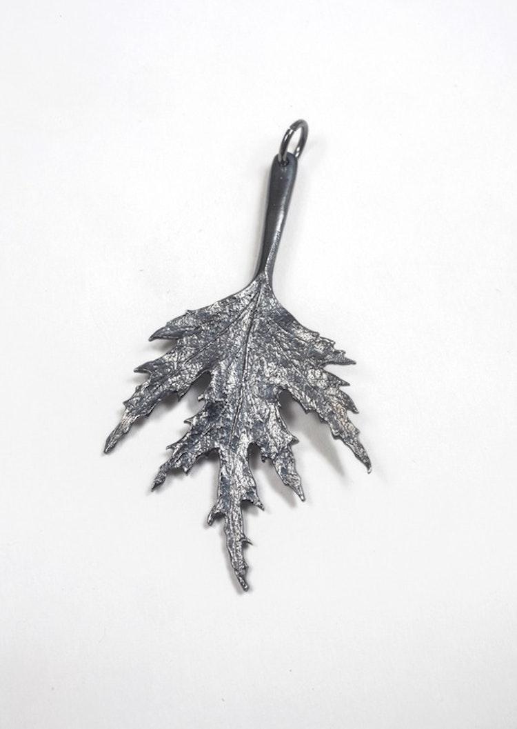 Hänge Mellan oxiderat Silver