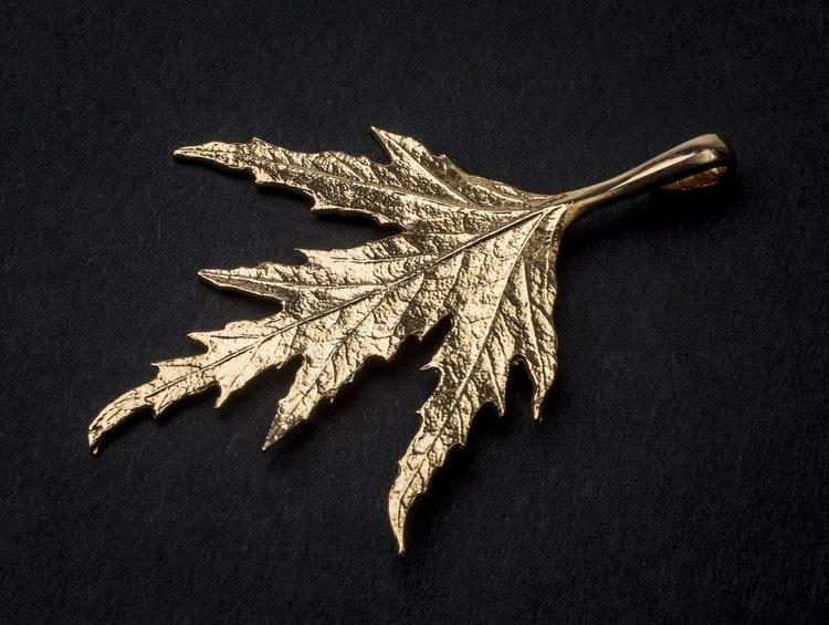Ornässmycket 18k guld