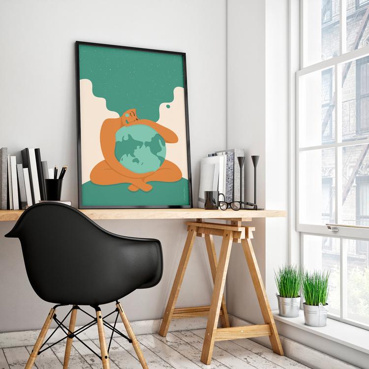 Poster med den turkosa Moder Jord inramad på ett skrivbord. Format 50x70 cm.