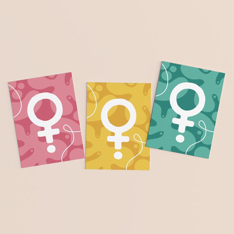 Vykort i 3-pack. Motiv: Venus (venussymbol / kvinnosymbol / feministsymbol). Färg: rosa, gul och turkos.
