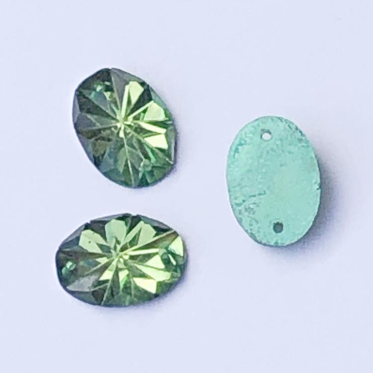 Pärla platt oval 14x10mm facetterad pistagegrön