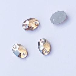 Kristallpärla platt oval 7x10mm guld