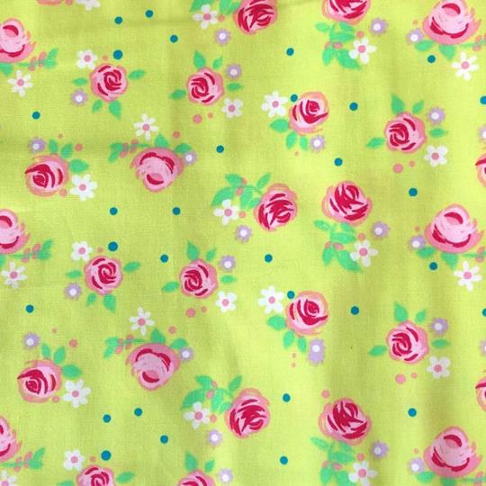 Bomullstyg blommigt lime rosa