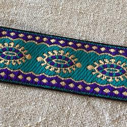 Dekorband turkost med ovaler i blått och guld