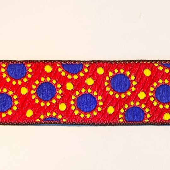 Dekorband rött med blå prickar