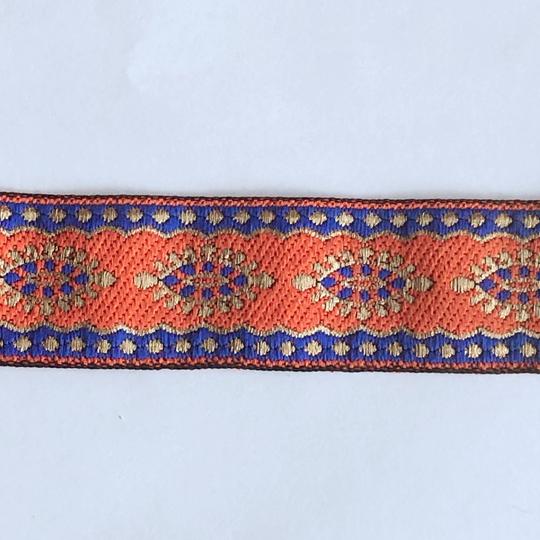 Dekorband orange med ovaler i blått och guld