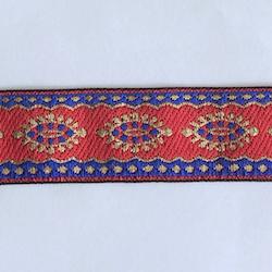 Dekorband rött med ovaler i blått och guld