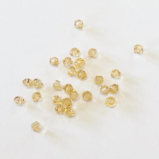 Pärla bicone glas blekguld 3mm