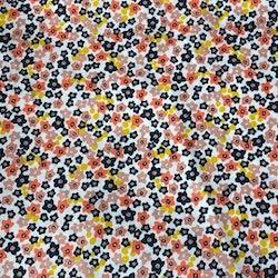 Bomullstyg småblommigt gult svart orange