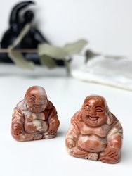Buddha av röd jaspis