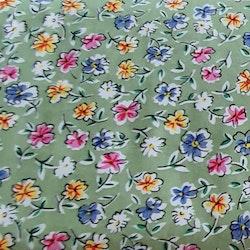 Färglada blommor på grön botten