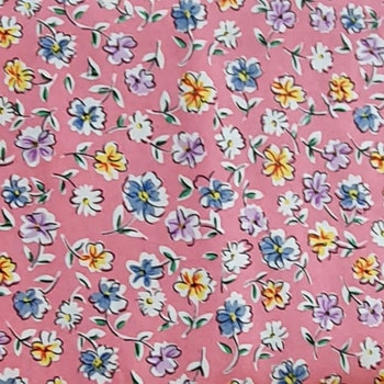 Färgglada blommor på rosa botten