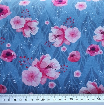 Blå blad med rosa blomma