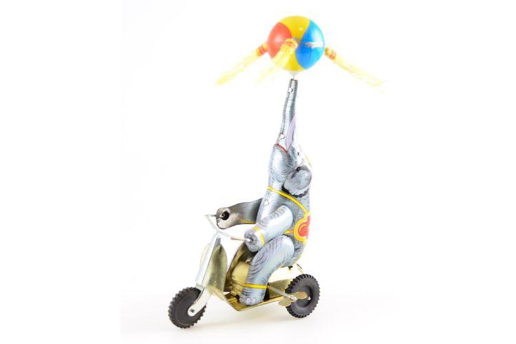 Elephant on a three-wheeled bike
