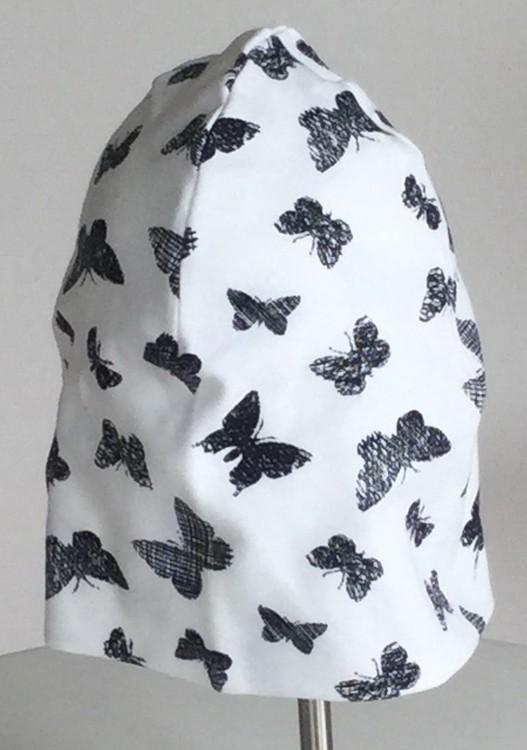 Svart Fjäril vit botten