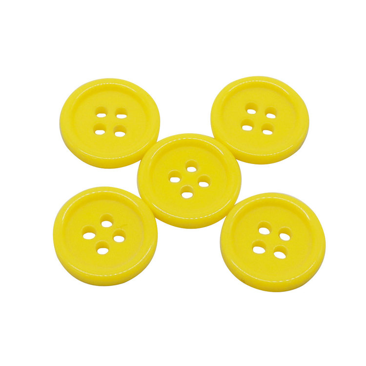10st knappar i plast. 15mm. Välj mellan 11 olika färger.
