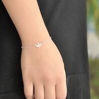 Armband med liten fågel