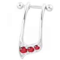 Helix piercing med röda ädelstenar
