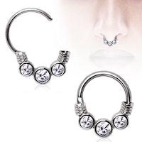 Septum piercing med tre ädelstenar