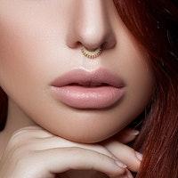 Piercingring med boll mönster