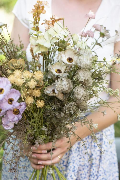 Blomma i lila/grön ton, plast