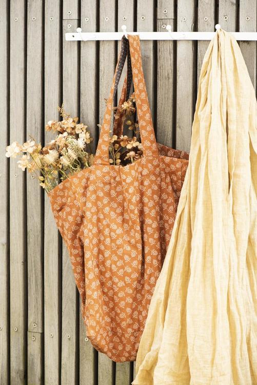 Blomma i orange/grön ton, plast