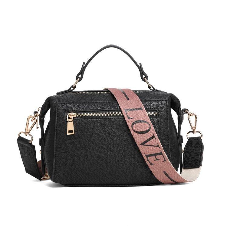 Handväska svart med mönstrad axelrem. Konstskinn. Två medföljande axelremmar
