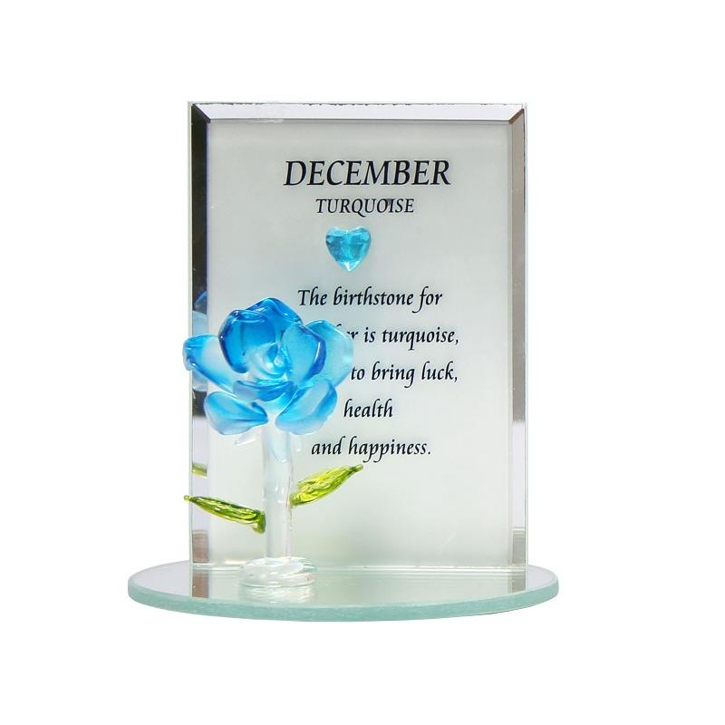 Spegel med månadssten och ros av glas