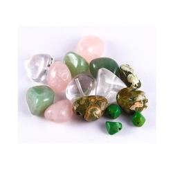 Pärlor av trumlad sten