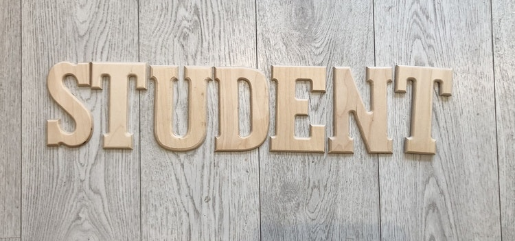 Student träbokstäver